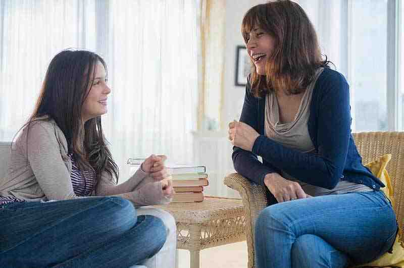A teenage girl having a casual conversation with her Mum