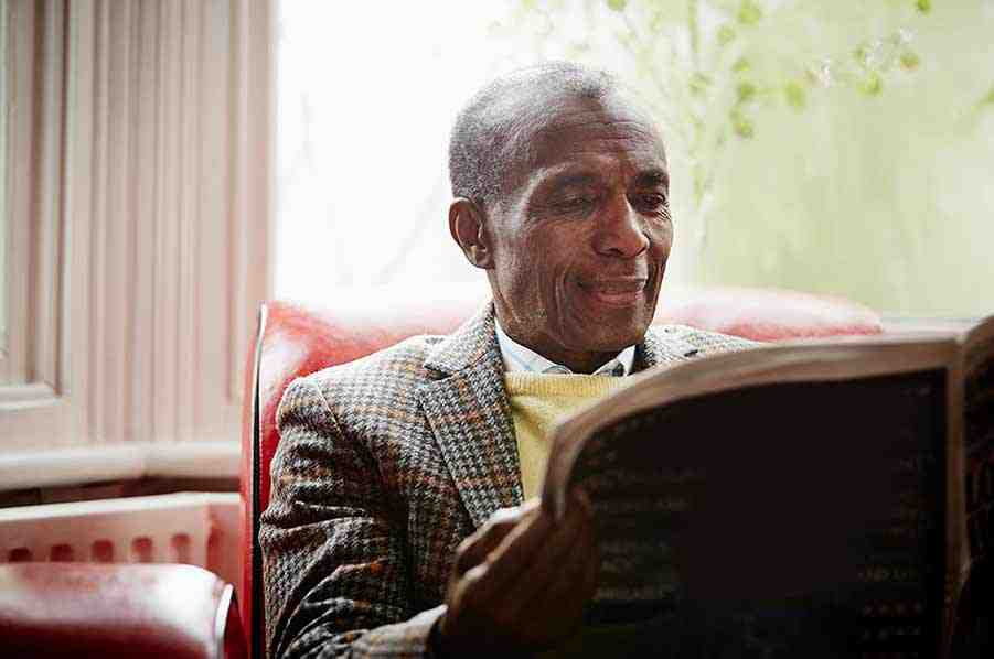 Image of a mature man reading the newspaper